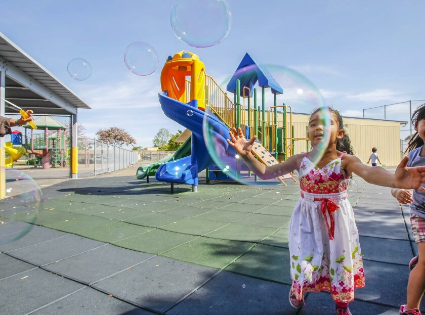 Nadxieli Medina, 4, pops bubbles during recess time at Mi Escuelita school in Chula Vista.