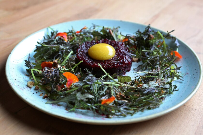 The beet tartar with mustard greens, almond and preserved lemon at Kali Restaurant.