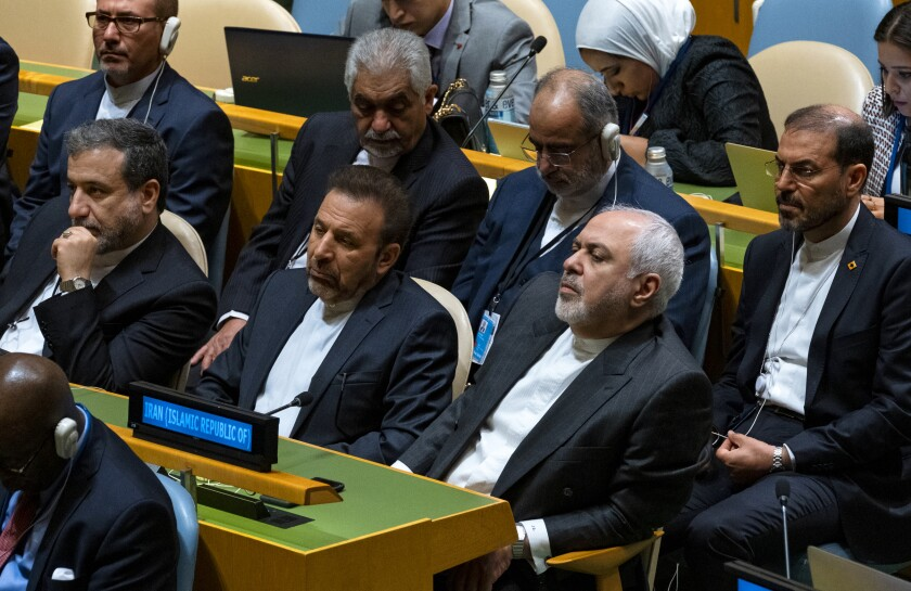 Iranian Foreign Minister Mohammad Javad Zarif, center far right, and others in the Iranian delegation listens to Iran's President Hassan Rouhani address the 74th session of the United Nations General Assembly, Wednesday, Sept. 25, 2019. (AP Photo/Craig Ruttle)