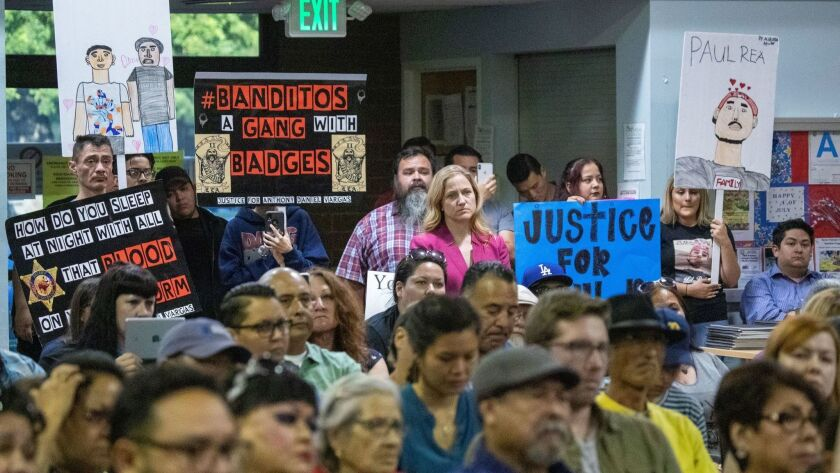 Residents speak out about the East Los Angeles station of the Sheriff's Department at a meeting Thursday, the same day news broke of an FBI probe into the Banditos, an inked deputy gang at the station.