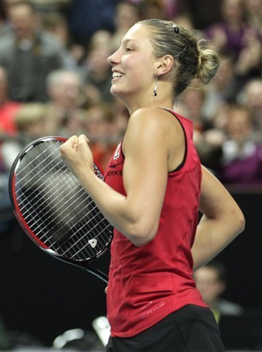 Belgium's Yanina Wickmayer celebrates defeating US player Bethanie Mattek-Sands during the World Group Fed Cup match in Antwerp, Belgium, Saturday, Feb. 5, 2011. (AP Photo/Yves Logghe)