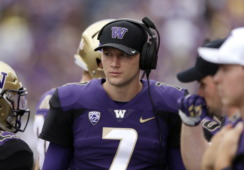 Quarterback Colson Yankoff when he was at Washington in 2018, watching from the sidelines.
