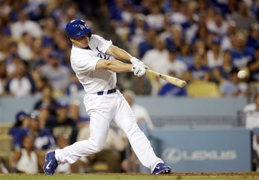 Los Angeles Dodgers' Mark Ellis hits a RBI single against the San Diego Padres during the eighth inning of a baseball game on Saturday, Aug. 31, 2013, in Los Angeles. (AP Photo/Jae C. Hong)