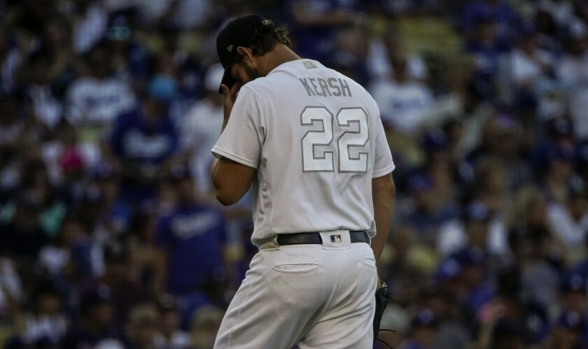 Dodgers starter Clayton Kershaw walks to the dugout during Sunday's 5-1 loss to the New York Yankees.