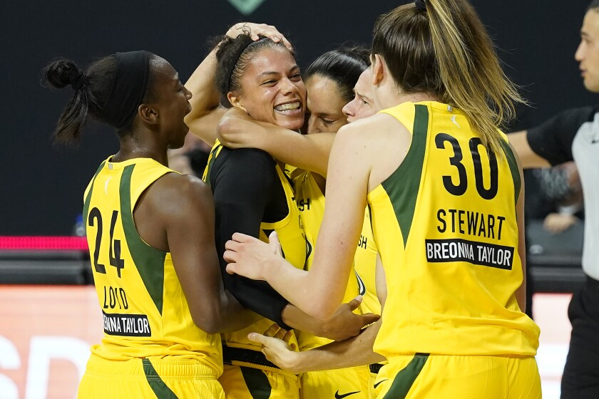 Seattle Storm forward Alysha Clark celebrates her game-winning shot with guard Jewell Loyd (24) and forward Breanna Stewart (30) during the second half of Game 1 of a WNBA basketball semifinal round playoff series against the Minnesota Lynx Tuesday, Sept. 22, 2020, in Bradenton, Fla. (AP Photo/Chris O'Meara)