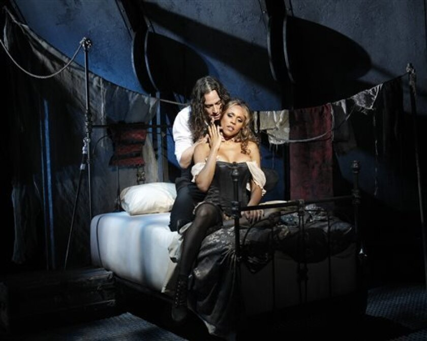 """This theater publicity image released by The Hartman Group shows Constantine Maroulis, left, and Deborah Cox during a performance of """"Jekyll & Hyde"""" playing at the Marquis Theatre in New York. (AP Photo/The Hartman Group, Chris Bennion)"""