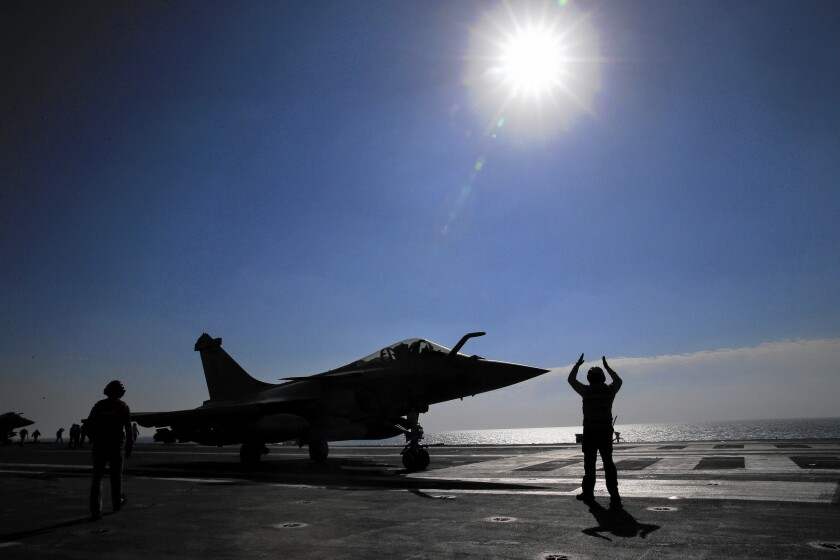 A French jet is prepared for launch in the Persian Gulf last month. In October, coalition air raids began targeting suspected Islamic State cash hoards.