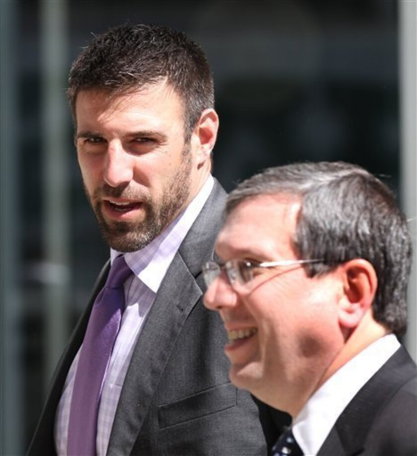 Football player Mike Vrabel, leaves the Federal Courthouse in St. Paul, Minn. Wednesday, April 6, 2011 after a break in a hearing by in which the NFL players are seeking to lift the lockout by team owners.(AP Photo/Andy King)