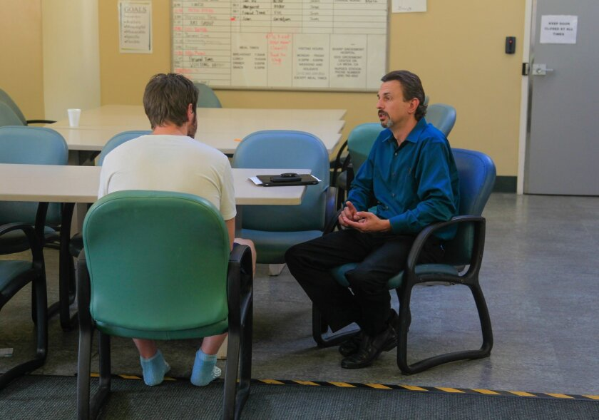 Dr. Brian Miller (right) works with a patient in the Intensive Treatment Program 1 facility of the Behavioral Health Department at Sharp Grossmont Hospital on Thursday in La Mesa, California.