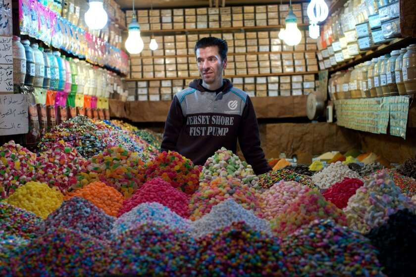 A Syrian shopkeeper waits for customers at the popular Souk Tawil old market in Damascus, Syria, Wednesday, Feb. 24, 2016. Russia's President Vladimir Putin spoke Wednesday with key players in the Syrian conflict including President Assad, ahead of a U.S.-Russia-engineered cease-fire, as the opposition and its backers voiced concerns that the proposed truce due to begin later this week would benefit the Syrian government. (AP Photo/Hassan Ammar)