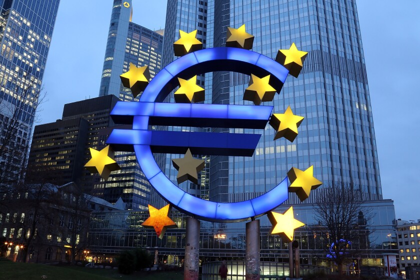 A sculpture in Frankfurt, Germany, depicts the symbol of the euro currency.