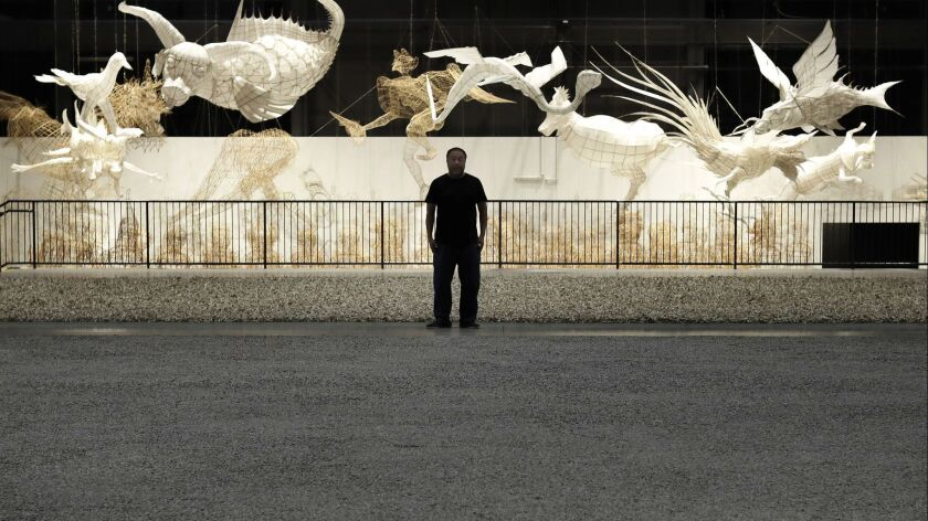 Artist Ai Weiwei looks over his 2018 installation at the Marciano Art Foundation.