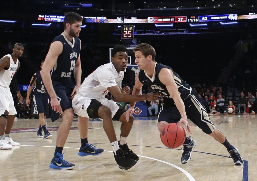 George Washington's Alex Mitola (1) drives past San Diego State's Jeremy Hemsley (42) as Patricio Garino (13) sets a pick during the second half of an NCAA college basketball game in the semifinals of the NIT on Tuesday, March 29, 2016, in New York. George Washington won 65-46. (AP Photo/Frank Franklin II)