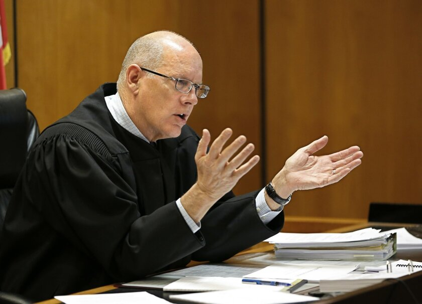 Sacramento Superior Court Judge Michael Kenny questions attorney Stuart Flashman, about his argument against California's high-speed rail project, during a hearing, Thursday, Feb. 11, 2016, in Sacramento, Calif.  Flashman who represents a group of Central Valley farmers opposed to the plan,  argued