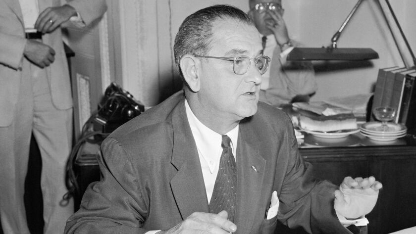 Then-Sen. Lyndon Johnson, D-Texas, holds a news conference barring churches and tax-exempt groups from endorsing political candidates in Washington on July 30, 1954.
