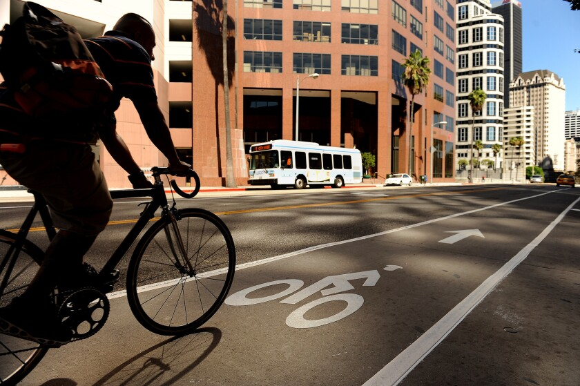 A bike lane on 7th Street is one of several such pedal-focused commuter lanes introduced in downtown Los Angeles. Efforts are underway to put more people on bikes and public transit.