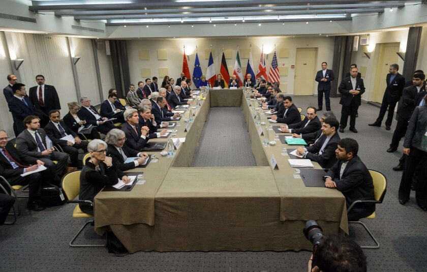 European Union officials and Iranian officials start a meeting on Iran's nuclear program at the Beau Rivage Palace Hotel in Lausanne, Switzerland, on March 30.