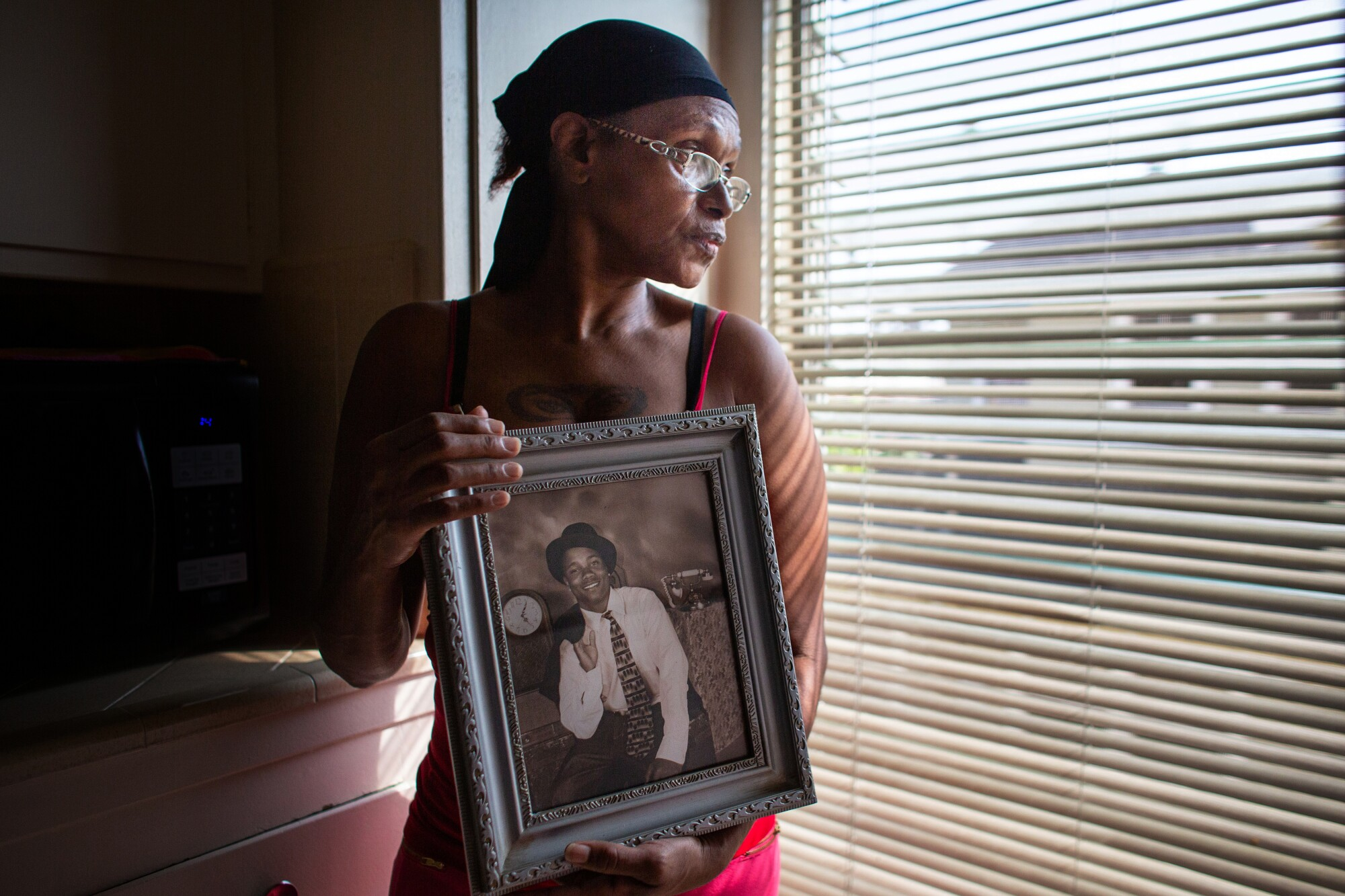 Vershell Hall holds a photo of her son Richard Tyson