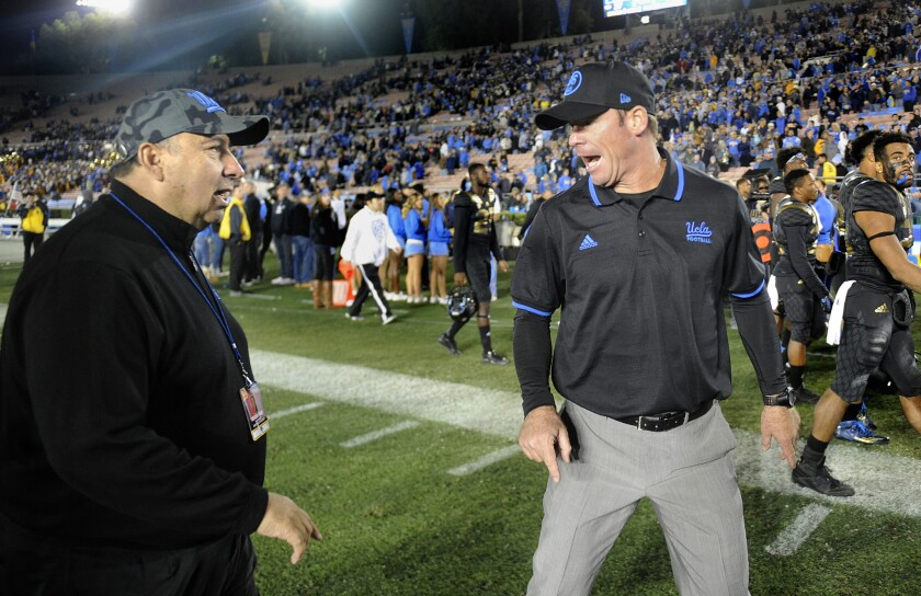 UCLA coach Jim Mora, right, has words with Athletic Director Dan Guerrero after losing to Washington State in 2015.