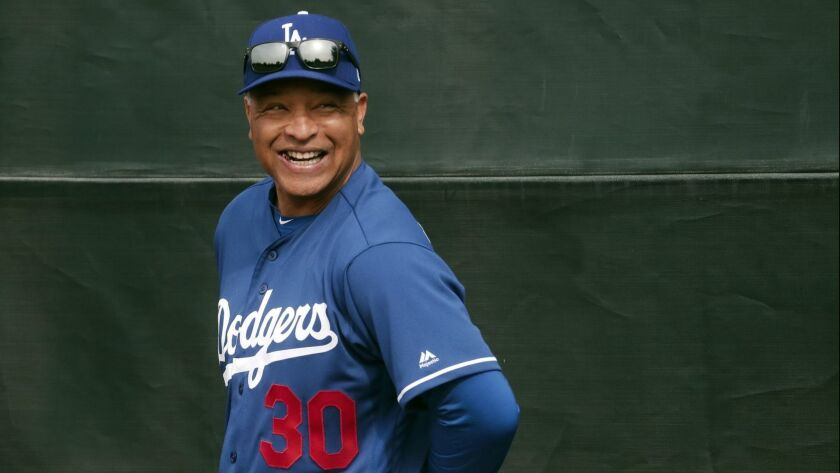 FILE - In this Feb. 13, 2019, file photo, Los Angeles Dodgers manager Dave Roberts smiles during a s