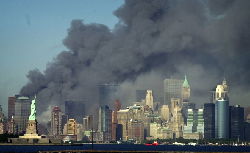 Smoke billows into the sky from the area of the  World Trade Center  on Sept. 11, 2001.