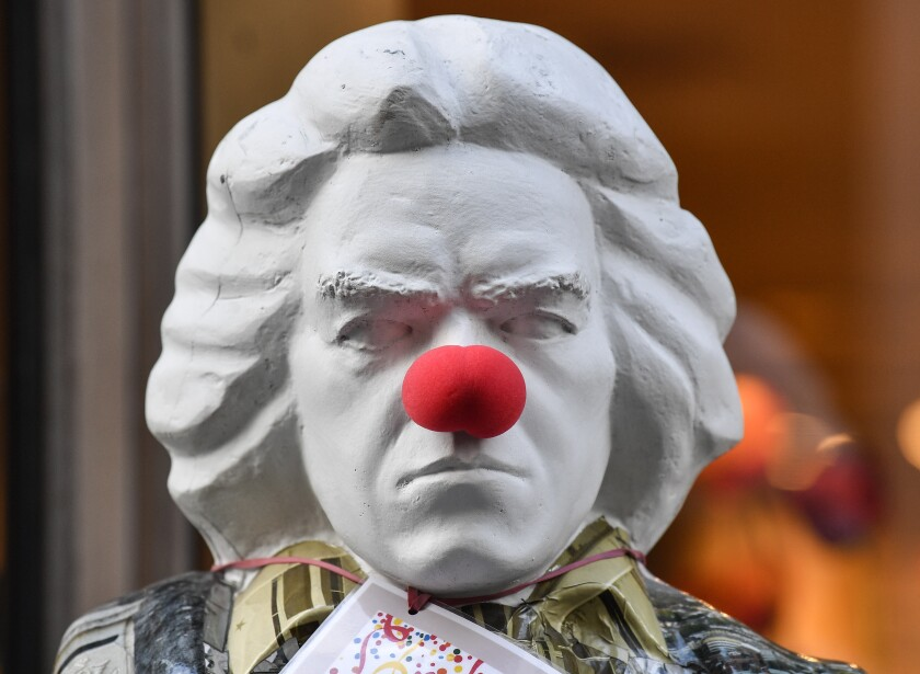 A bust of Ludwig van Beethoven adorned with a red nose in Bonn, Germany.