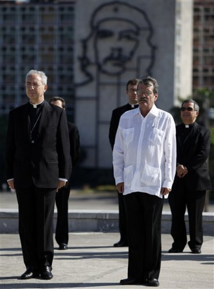 Vatican Foreign Minister Archbishop Dominique Mamberti, left, and Cuba's Vice-Foreign Minister Abelardo Moreno attend a wreath-laying ceremony at the Jose Marti monument in Havana, Wednesday, June 16, 2010. Mamberti is in Cuba to to discuss the island's economic plight and meet with government auth