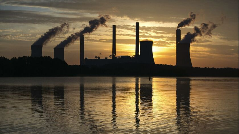 FILE - In this June 3, 2017, file photo, the coal-fired Plant Scherer, one of the nation's top carbo