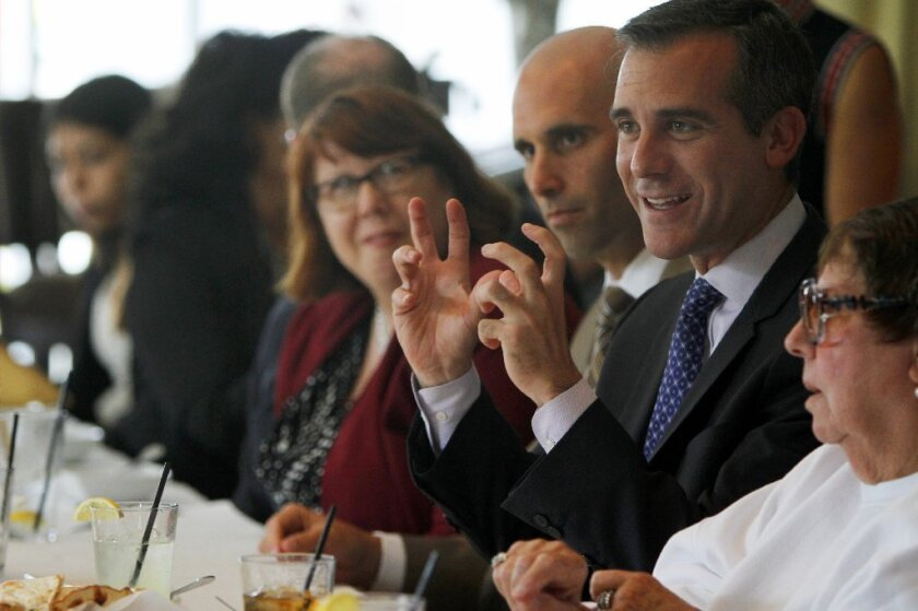 Los Angeles Mayor Eric Garcetti, shown at a private lunch last month, on Saturday rallied teachers gathered at a national convention in downtown Los Angeles.