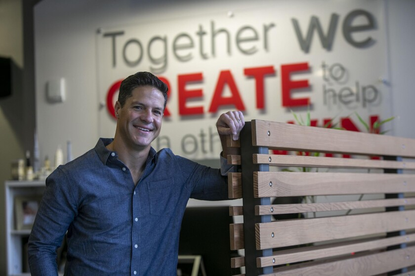 Reid Carr, CEO of Red Door Interactive, in the company's current location next to Petco Park. The communications company has purchased three buildings and is moving to the 2400 block of Market Street in Sherman Heights, an opportunity zone area.