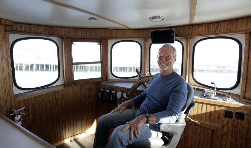 In this Thursday, Nov. 19, 2015, photo, Phil Cruver, CEO of Catalina Sea Ranch, poses for a picture aboard the Captain Jack in San Pedro, Calif. Some 90 percent of seafood consumed by Americans is imported, a fact that the Obama administration vowed to start turning around by expanding fish and shellfish farms into federal waters. Yet nearly two years since the first permit was issued, the United States still has no offshore farms. (AP Photo/Chris Carlson)