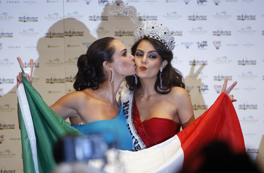 Miss Universe 1991 Lupita Jones, of Mexico, left, kisses Mexican Miss Universe 2010 Jimena Navarrete at Las Vegas pagaent.