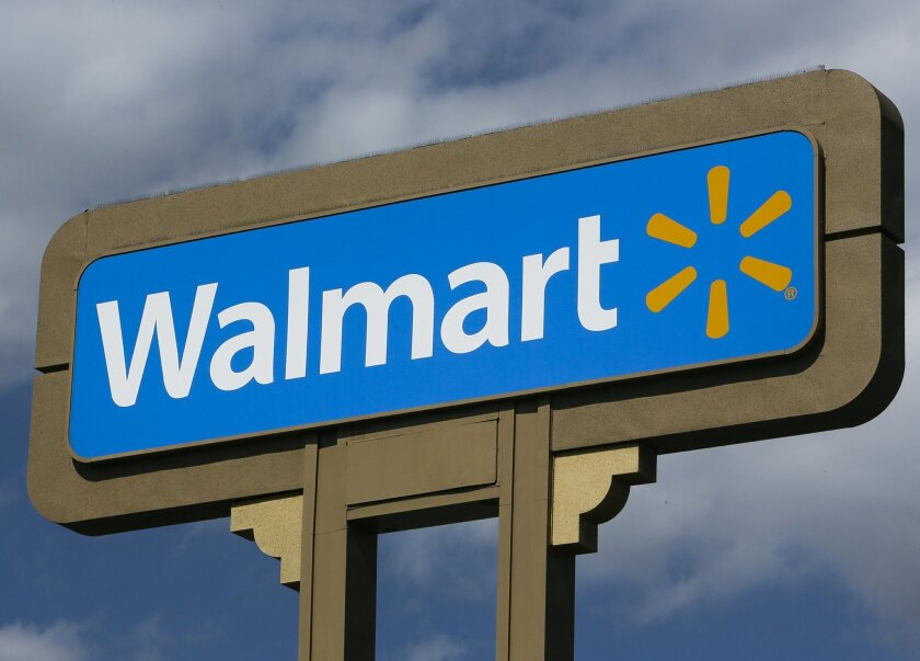 FILE - This May 28, 2013 file photo shows a sign outside a Wal-mart store in Duarte, Calif. Wal-Mart will stop selling the AR-15 rifle and other semi-automatic weapons at its stores because fewer people are buying them, a spokesman said Wednesday, Aug. 26, 2015. (AP Photo/Damian Dovarganes, File)