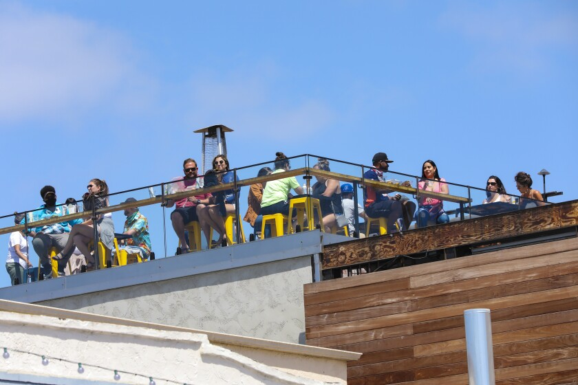 Diners eat on the rooftop at The Holding in Ocean Beach, which opened just in time for the Memorial Day holiday.