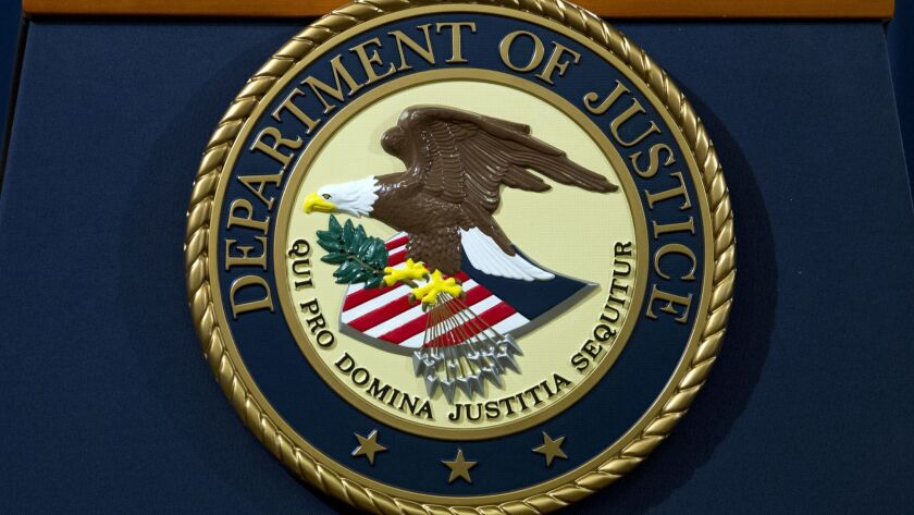 The Department of Justice seal is seen, ahead of a news conference of Deputy Attorney General Rod Ro