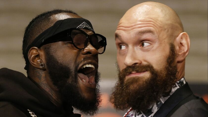 Boxers Deontay Wilder and Tyson Fury exchange words during a news conference on Nov. 28, 2018.