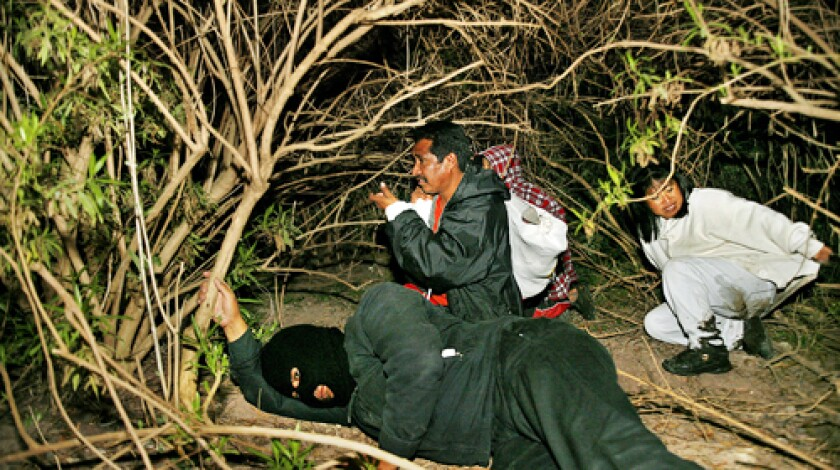 Tourists spend a night as illegal immigrants crossing the Rio Grande at the Eco Alberto Nature Park. The park offers a border crossing simulation organized by the Nhanhu Indian community.