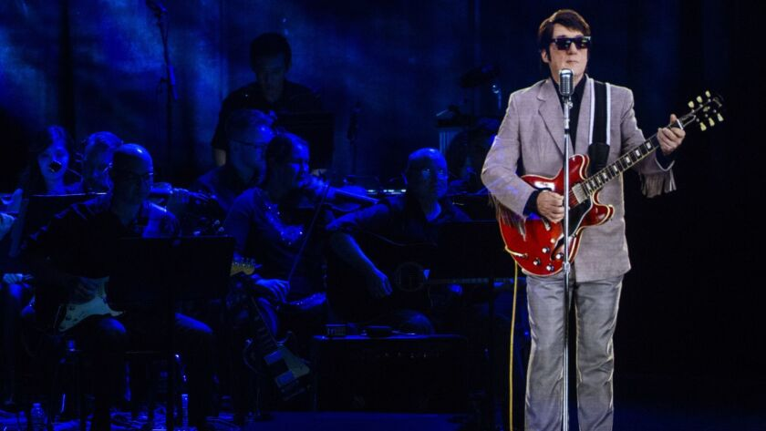 LOS ANGELES, CALIF. - OCTOBER 02: A hologram of Roy Orbison performs with the Los Angeles Orchestra