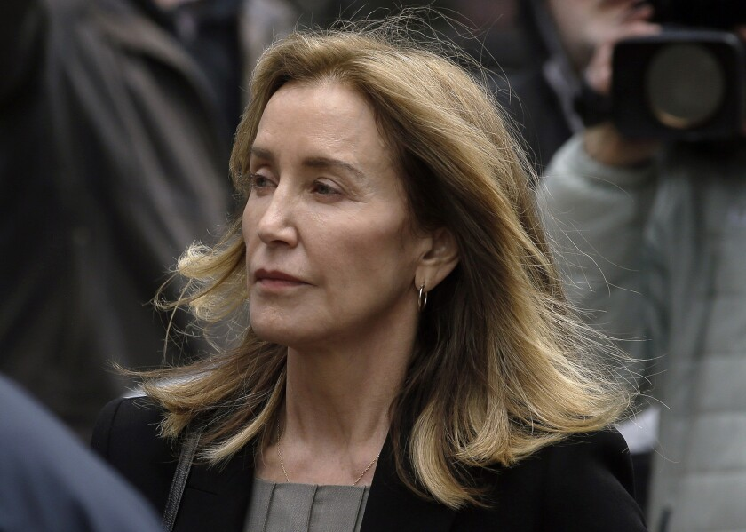 Felicity Huffman gets 14 days in prison in college admissions scandal