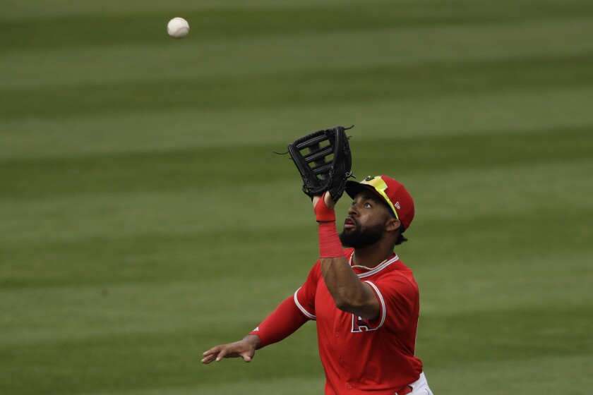 Angels center fielder Jo Adell catches a fly ball during the fifth inning Feb. 28, 2020.