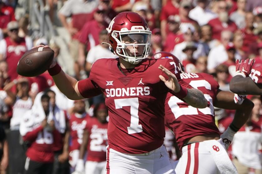 Oklahoma quarterback Spencer Rattler (7) throws in the first half of an NCAA college football game against Nebraska, Saturday, Sept. 18, 2021, in Norman, Okla. (AP Photo/Sue Ogrocki)