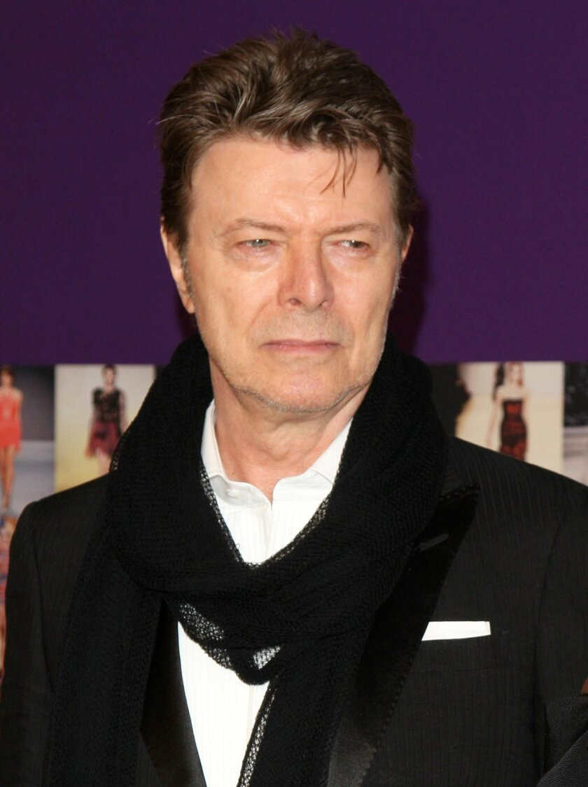 """FILE - In this June 7, 2010 file photo, David Bowie attends the 2010 CFDA Fashion Awards in New York. The New York Theatre Workshop said Thursday, April 2, 2015, that Bowie will team up with """"Once"""" playwright Enda Walsh to create the musical """"Lazarus"""" this winter. The show is inspired by Walter Tevis' 1963 novel """"The Man Who Fell to Earth,"""" which was adapted into a 1976 film starring Bowie. The new musical will have new and old Bowie songs . (AP Photo/Peter Kramer, File)"""