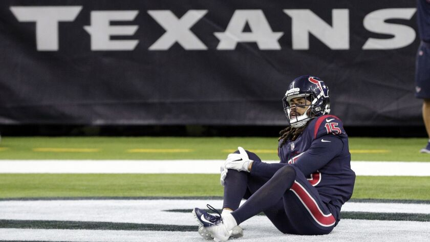 Houston Texans wide receiver Will Fuller (15) holds his knee during the second half of an NFL footba