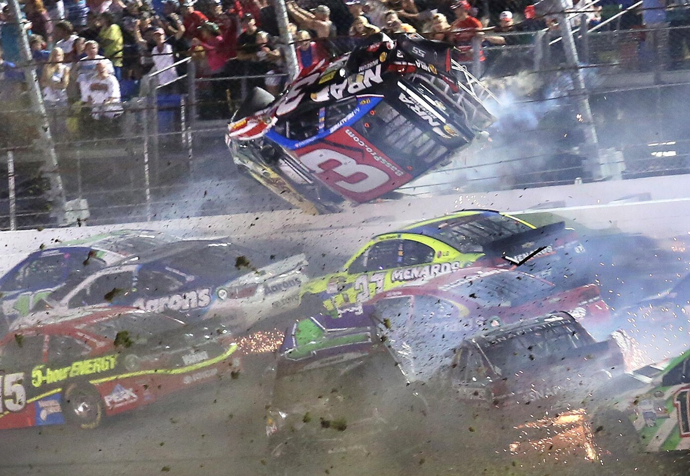 Austin Dillon (3) goes upside down as he crashes in a dramatic wreck during the Coke Zero 400 NASCAR Sprint Cup race at Daytona International Speedway on Sunday, July 5, 2015. (Stephen M. Dowell/Orlando Sentinel)