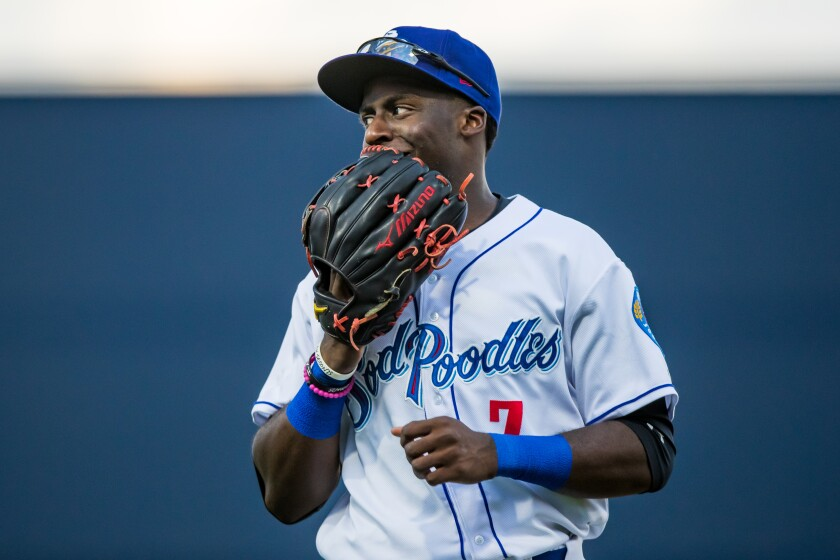 Padres prospect Taylor Trammell of the Amarillo Sod Poodles talks under his glove during the game against the Northwest Arkansas Naturals at HODGETOWN Stadium on August 02, 2019 in Amarillo, Texas.