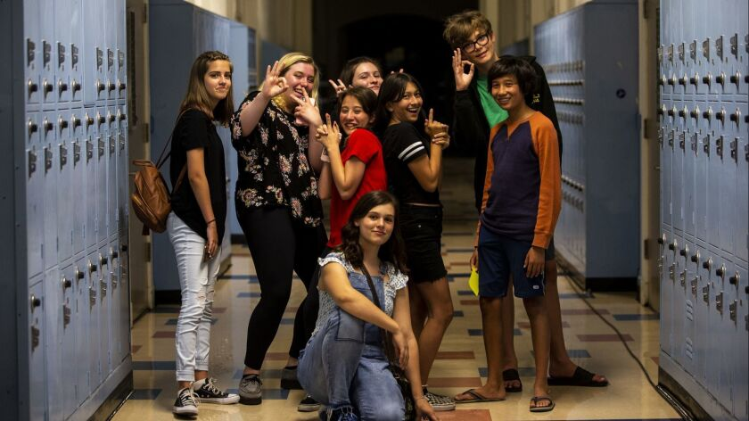 "Kaylee Leffler, left, Elizabeth Heuer, Gisele Ortiz, Leila Curran, Emily Cliborn, Heather Morales, Jake Eaton and Asher Burstin pose for a portrait after discussing Bo Burnham's ""Eighth Grade."""