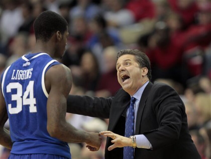 Kentucky head coach John Calipari makes a point to Kentucky Wildcats guard DeAndre Liggins (34) during the second half of an NCAA college basketball game against the Georgia Saturday, Jan. 8, 2011 in Athens, Ga.. (AP Photo/John Bazemore)