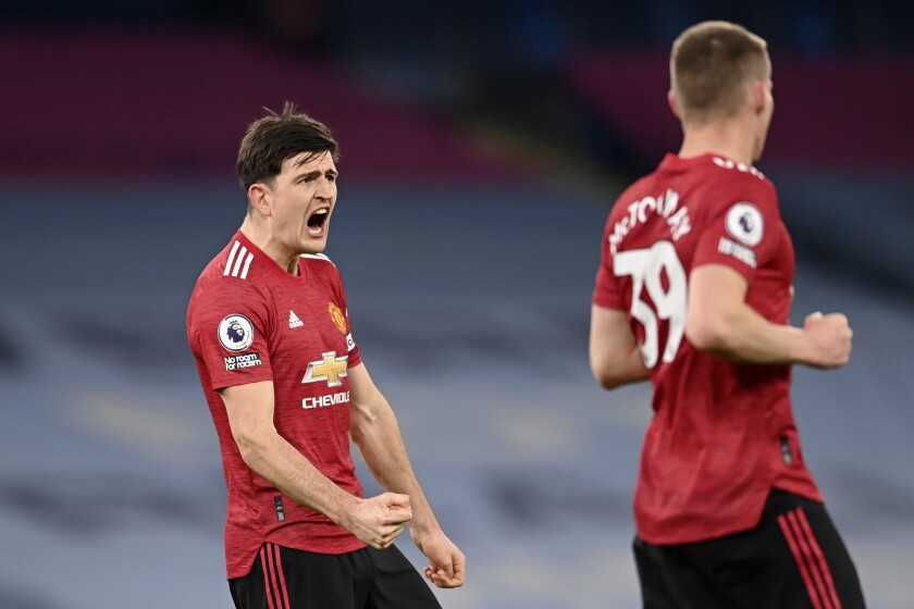 Manchester United's Harry Maguire celebrates at the final whistle during the English Premier League soccer match between Manchester City and Manchester United at the Etihad Stadium in Manchester, England, Sunday, March 7, 2021. Manchester United won 2-0. (Laurence Griffiths/Pool via AP)