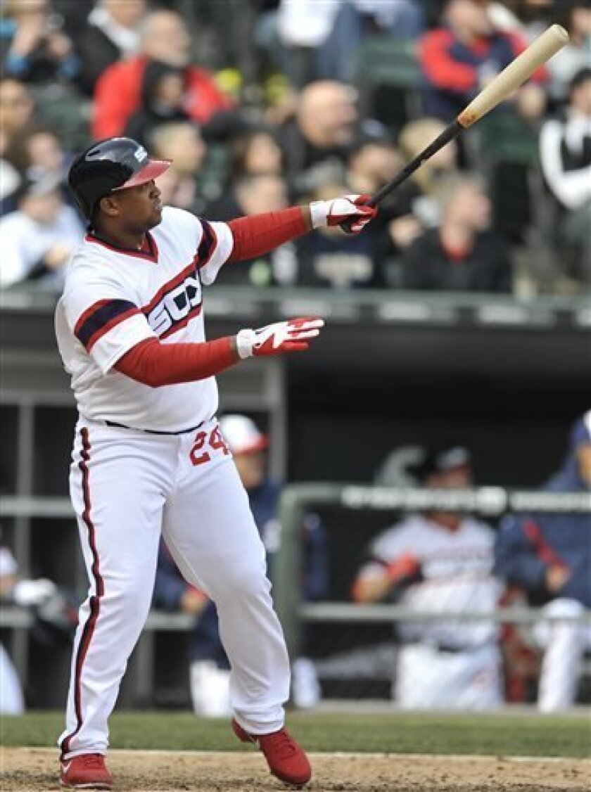 Chicago White Sox's Dayan Viciedo watches his walk-off home run during the tenth inning of an MLB baseball game against the Seattle Mariners in Chicago Sunday April 7, 2013. Chicago won 4-3. (AP Photo/Paul Beaty)