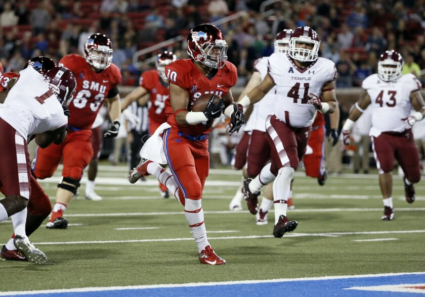 SMU running back Xavier Jones (10) runs for a touchdown as he leads Temple linebacker Jarred Alwan (41) into the end zone in the first half of an NCAA college football game Friday, Nov. 6, 2015, in Dallas. (AP Photo/Tony Gutierrez)